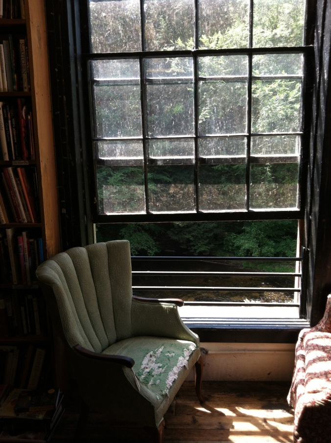 Comfy chairs by a window overlooking the river