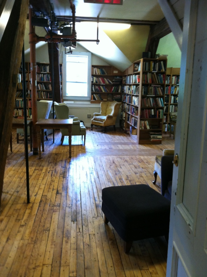The large upstairs nonfiction room; to the right, out of the frame, is a walkway, another entrance.