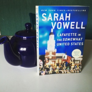 American author, French subject, British teapot.